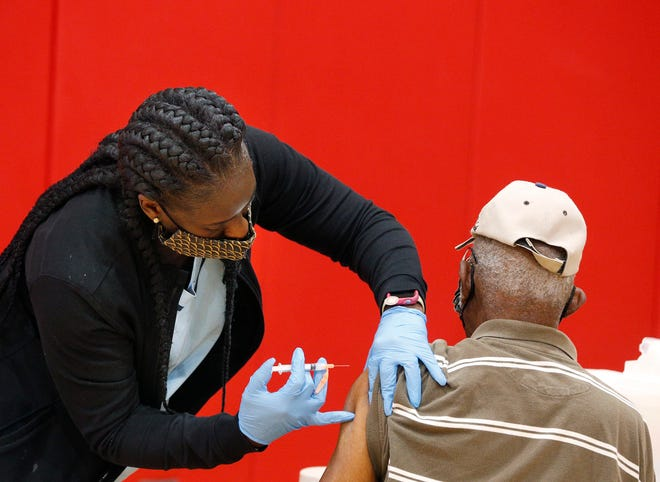 Individuals receive the Covid 19 vaccine at Chisholm Community Center in DeLand, Wednesday, Feb 24, 2021.