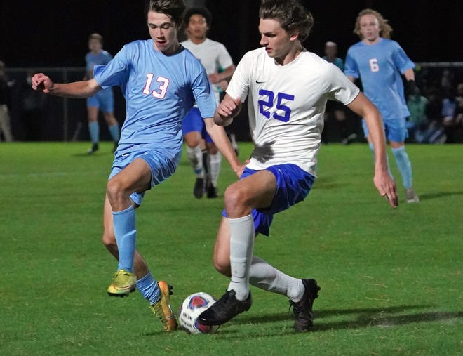 Stanton defender Ethan Alesch (25) advances the ball upfield as Seabreeze's Cole Miller challenges during the Region 1-5A boys soccer final in February.