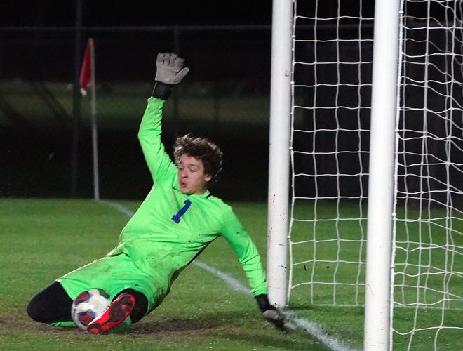 Stanton goalie Sebastian Brunner (1) makes the save during Tuesday night's Region 1-5A boys soccer final game with Seabreeze.
