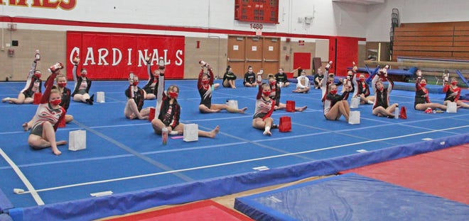 The Coldwater Lady Cardinal Gymnastics team, shown here at the Jillian Crist Memorial Meet, secured their final Regional qualifying score in their meet with Angola on Monday.