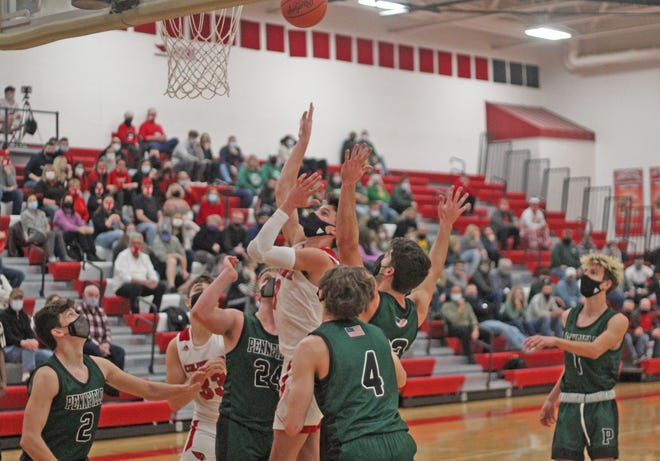 Coldwater's Ethan Crabtree goes up strong in the paint among a pack of Panthers for two of his team high 14 points Tuesday night