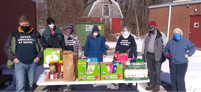Dover Democrats are collecting food for End 68 Hours of Hunger the second Saturday of each month. From left to right are Jim Verschueren, Rob Gordon, Kathleen Letellier, Kristine Baber, Cindy Walter, Mike Atherton and Pam Raley. The next collection will be Saturday, March 13.