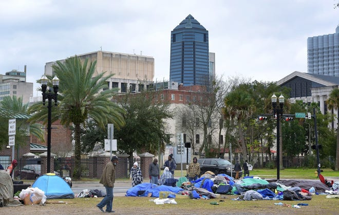 Part of a homeless camp — with tents, makeshift shelters, personal items and garbage — is shown along North Jefferson Street and West Beaver Street in early February.