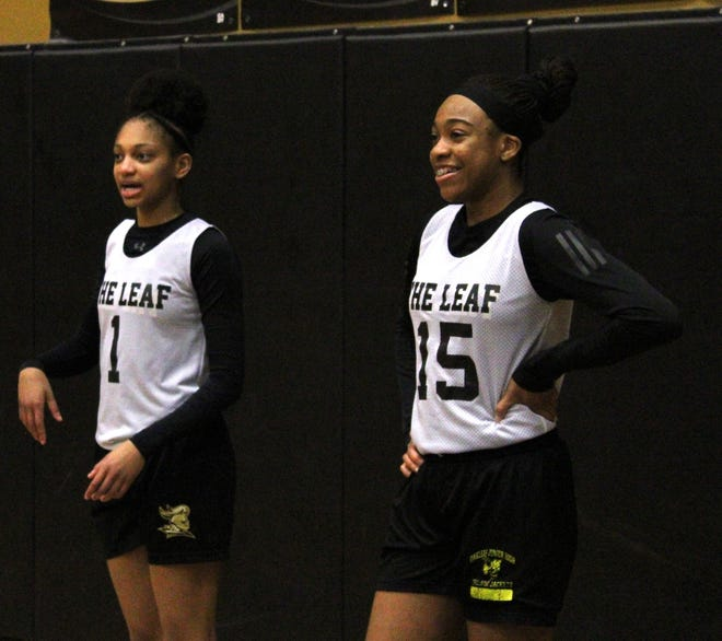 Oakleaf's Taliah Scott (1) and Fantasia James (15) talk during a pause in a high school girls basketball practice on February 22, 2021. [Clayton Freeman/Florida Times-Union]