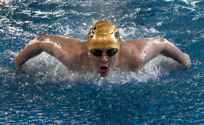 Garden City High School's Jeremiah Bunce comes up for a breaath and stroke during a 200-yard IM race in a home swim meet earlier this month.