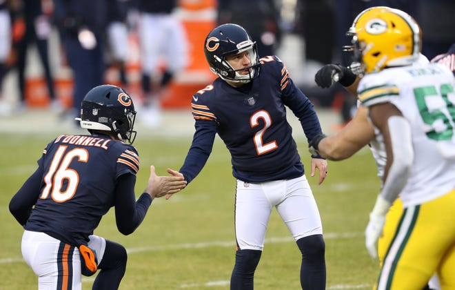 Bears kicker Cairo Santos (2) is congratulated by teammate Pat O'Donnell (16) after a field goal against the Green Bay Packers on Jan. 3, 2021, at Soldier Field.