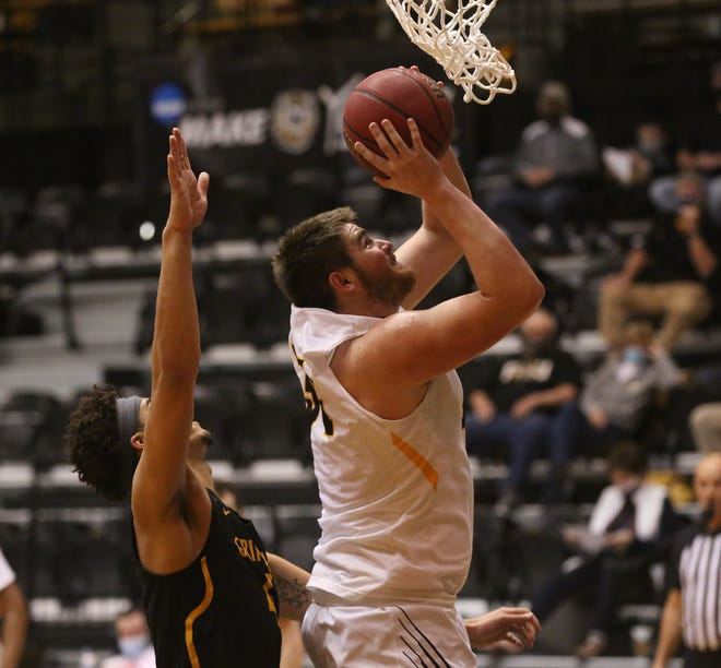 Fort Hays State's Gilbert Peters scores inside during Tuesday's game vs. Missouri Western at Gross Memorial Coliseum. The Tigers lost 78-73.