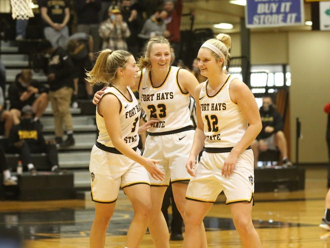 Sydney Golladay, left, Katie Wagner, middle, and Madison Mittie celebrate the Fort Hays State women's basketball team's win against Central Missouri last Saturday.