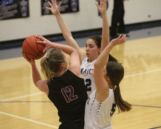 TMP's Kyleigh Allen, left, and Hannah Garcia, pressure Plainville's Brady Bouchey during Tuesday's game at Al Billinger Fieldhouse.