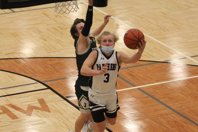 West Ottawa's Kobe Haglund goes up for a layup in the first half of their win over Jenison on Tuesday, Feb. 23, 2021