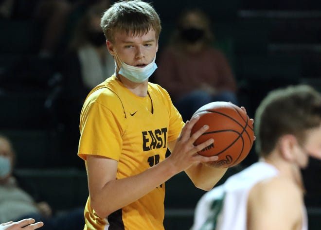 Zeeland East's Nate Claerbaut looks to pass the ball against Zeeland West.