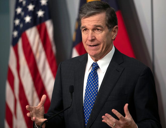 Gov. Roy Cooper speaks at a press briefing Feb. 18 at the Emergency Operations Center in Raleigh. North Carolina civil right rights groups struck a deal Thursday with Gov. Roy Cooper's administration to allow for the early release of 3,500 inmates in state custody over the next six months.  (Robert Willett/The News & Observer via AP)