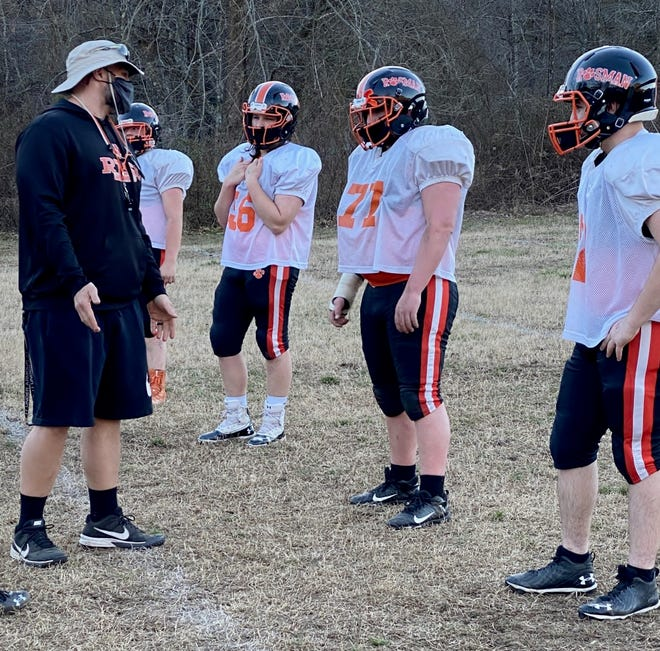 Rosman head football coach Dusty Robinson, left, talks with his linemen during Monday's practice at Rosman.