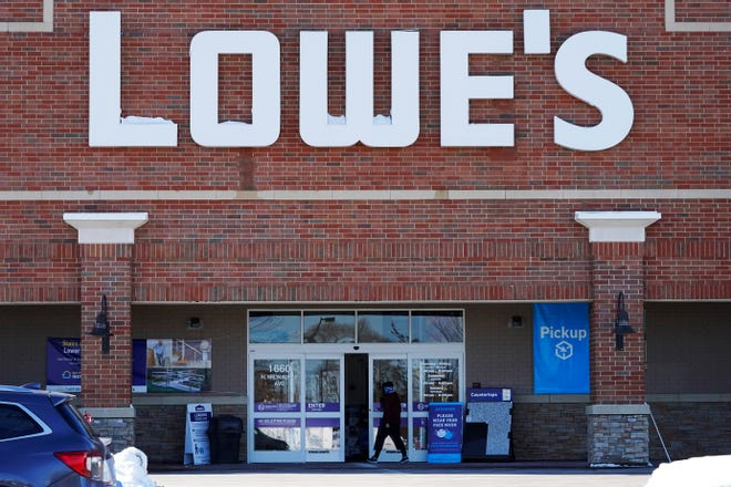 A customer walks to a Lowe's home-improvement store in Vernon Hills, Ill. Feb. 3, 2021. Lowe's Cos. extended its strong sales streak through the holiday season as customers kept investing in their homes during the pandemic. (AP Photo/Nam Y. Huh)