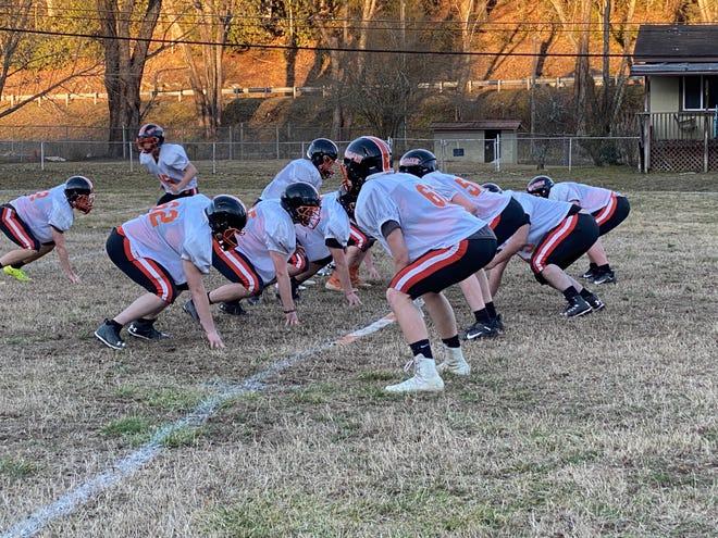Rosman's football players run through a drill on Monday during practice at Rosman.