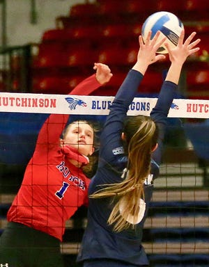 Hutchinson Community College's Jenna Thorne (1) spikes the ball past Colby's Olivia Navarro (6) during their game Tuesday night at the Sports Arena. HCC defeated Colby in four sets, 25-13, 25-9, 18-25, 25-16. Thorne had 16 kills in the game.