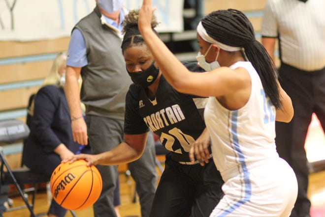 Croatan's Mia Raynor tries to get around East Duplin's Amiaya Hall during Tuesday's first-round playoff game. [Chris Miller / The Daily News]