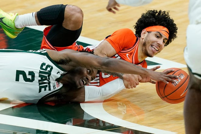 Michigan State guard Rocket Watts (2) and Illinois guard Andre Curbelo (5) chase the loose ball during the second half of an NCAA college basketball game, Tuesday, Feb. 23, 2021, in East Lansing, Mich.