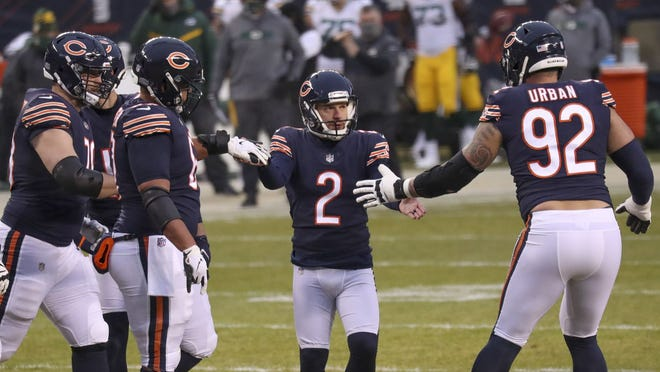Chicago Bears kicker Cairo Santos (2) celebrates with teammates after kicking a field goal against the Green Bay Packers on Jan. 3 at Soldier Field in Chicago.
