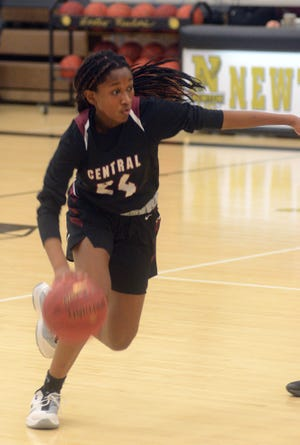Salina Central sophomore Mykayla Cunningham handles the ball during Tuesday night's game at Newton.