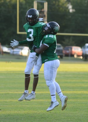 Savion White (3) and North Lenoir celebrate a touchdown in the first quarter Friday against Bunn in their 2019 game.