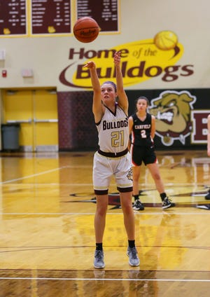 Stow senior Lilee Carlson shoots a free throw during the Bulldogs' 53-33 home win over Canfield Tuesday in a Division I district semifinal game. The free throw gave Carlson 1,000 career points. [Photo courtesy of Timothy Howard]