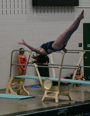 Pueblo West's Kenzee Pfeifer attempts her first dive of the tri-meet Tuesday, Feb. 23, 2021, at Pueblo County High School's pool.