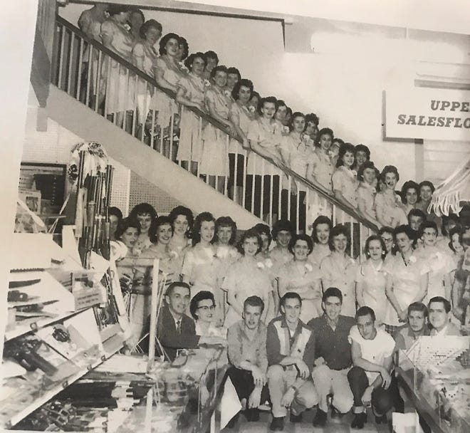 This picture of G.C. Murphy's employees lined up on the back steps of the store is believed to be from around 1961.