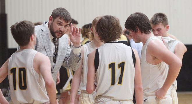 Higbee High School boys basketball coach Tanner Burton gives instructions to his players during a time out of a home game played earlier this 2020-21 season.  Higbee will play for the Class 1 District 10 championship Thursday after pulling out a thrilling 30-28 semifinal win Tuesday against Chamois.