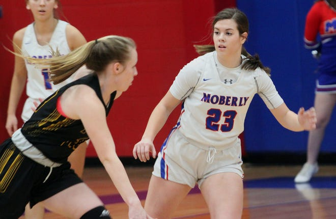 Moberly sophomore Kennedy Messer (#23) defends a Fulton player durirng a Feb. 4 home game played this season. Messer and the Lady Spartans lost to Fulton for the second time, 62-50 in a conference outing held at the Hornets home floor.