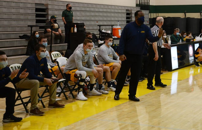Airport boys basketball coach Don Spencer gives instructions to his team during a game earlier this season.