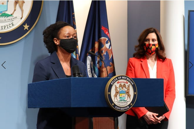 Dr. Joneigh Khaldun from the Michigan Department of Health and Human Services, at left; and Michigan Gov. Gretchen Whitmer, at right, during a State of Michigan press conference Wednesday.