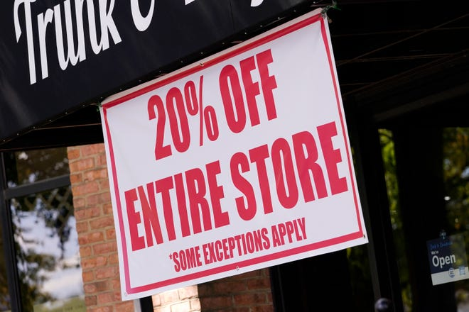 A sale sign is posted outside a store in Nashville, Tennessee, on Oct 1, 2020. There are now multiple layers of tax benefits for small business owners who took advantage of the Paycheck Protection Program. Business owners can claim otherwise deductible expenses, even if they were paid using PPP loan funds. [AP Photo/Mark Humphrey]
