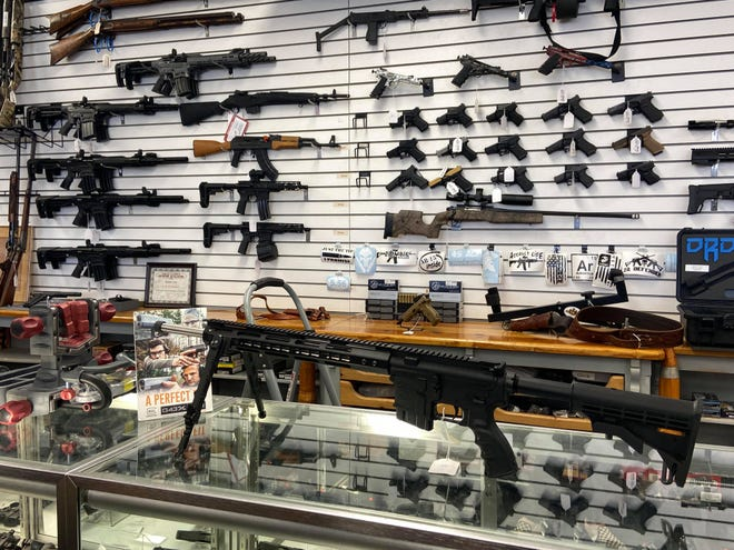 Guns on display at A&B pawn in Van Buren. Residents petitioned the Quorum Court to have Crawford County become a Second Amendment Sanctuary.