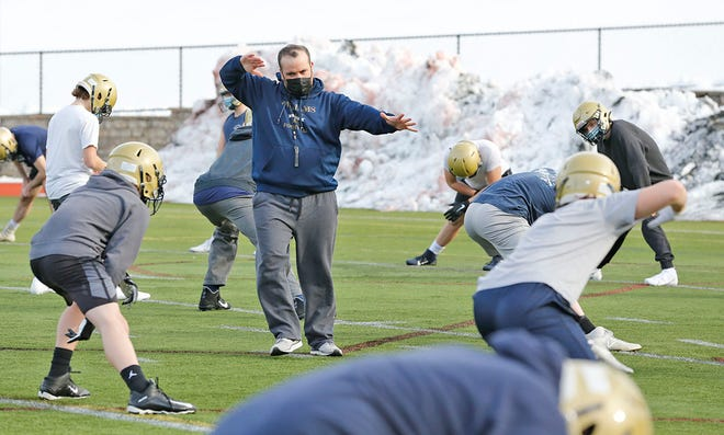 Coach Matt Reggiannini directs the Archbishop Williams football team at practice on Wednesday, Feb. 24, 2021.