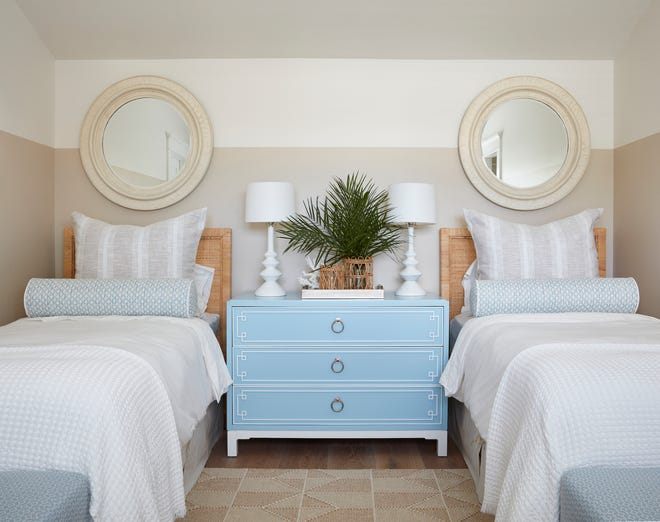 'She knew that she wanted quiet colors and a clean, uncluttered look,' said designer Margaret Kaywell of client Amy Viellieu. The clean look can be found in the twin guest room as well as throughout the house.