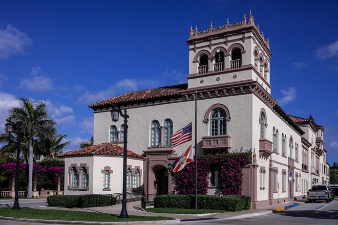 Flags at Palm Beach Town Hall fly at half-staff Wednesday. They were lowered on Tuesday to honor the 500,000 Americans who have died as a result of the coronavirus pandemic.