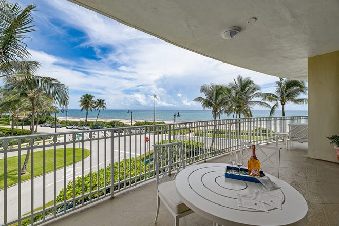 The balcony of Unit B3 at the One Royal Palm building looks across Royal Palm Way and the South Ocean Boulevard to the Atlantic Ocean.