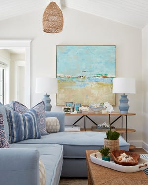 A sofa offers a place to relax in the second-floor TV room. Designer Margaret Kaywell worked with the home's owners on the interior design, including its furniture, flooring and lighting.