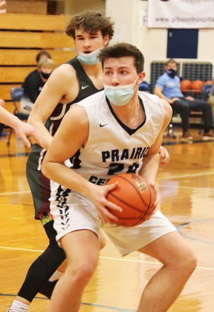 Andy Krenz of Prairie Central looks to find an open teammate during the Hawks' Illini Prairie Conference basketball game against Illinois Valley Central Tuesday. IVC topped the Hawks 68.56.