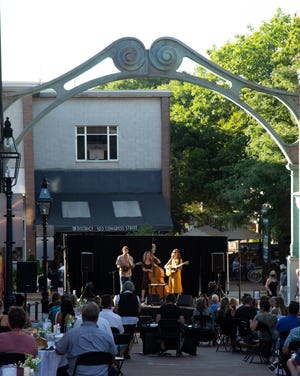 """The Old Hat String Band plays the outdoor performance series, """"Live Under The Arch,"""" in front of The Music Hall on Chestnut Street in Portsmouth last summer. The series will start up earlier this summer."""
