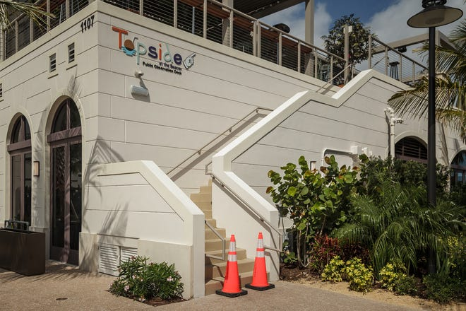 The three new restaurants at Jupiter Inlet's Love Street were temporarily closed due to COVID-19 exposure. Traffic cones restrict climbing stairs to Topside, the rooftop tapas bar at Beacon restaurant on Wednesday, Feb. 24.