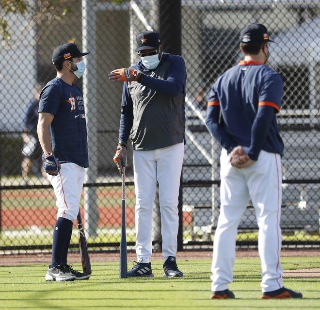 Houston Astros manager Dusty Baker talks with catcher Garrett Stubbs during spring training workouts Monday in West Palm Beach. (Karen Warren/Houston Chronicle via AP)