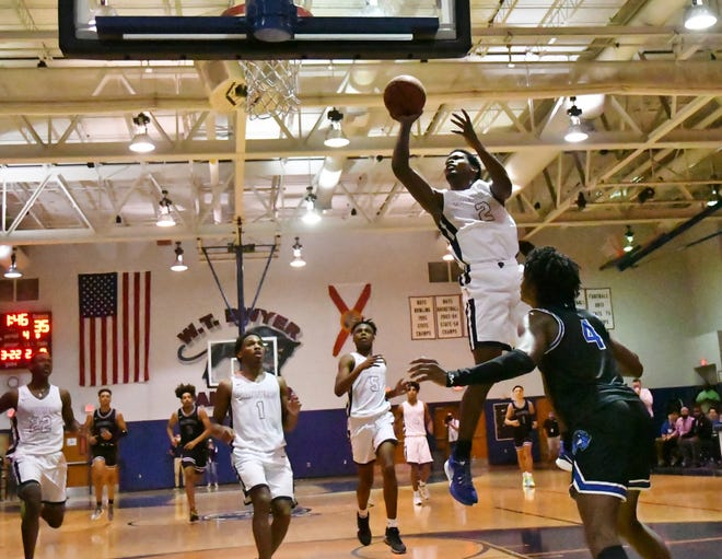 Dwyer's Rodrick Johnson Jr. pulls up for a mid-rang jump shot in the paint as the Panthers come off a fast-break. Dwyer defeated Wellington 52-49 to advance to the regional finals.