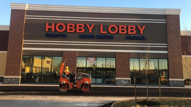 Road construction takes place in front of Hobby Lobby in the Bermuda Square retail center in Chester, Va. on Feb. 23, 2021.