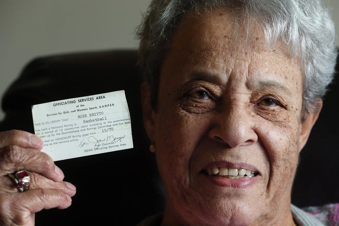 Rose Warner, 94, is perhaps the first person of color to referee youth and high school basketball games in Rhode Island. Here, she holds up her referee card that was issued to her after being certified.