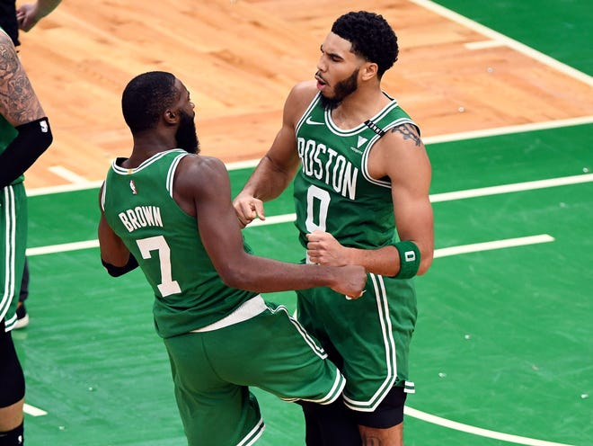 Celtics forward Jayson Tatum, right, celebrates with guard Jaylen Brown after scoring a basket against the Milwaukee Bucks during the game on Dec. 23 at TD Garden. Both players have been selected to play in the NBA All-Star game on March 7 in Atlanta.