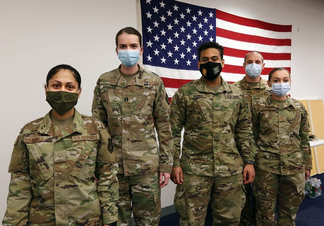 Members of the Rhode Island Army and Air National Guard at the state's COVID vaccine center in Cranston. From left: Airman 1st Class Karina Nunez, Capt. Regan Keenan, Pfc. Daniel Jimenez, Sgt. Matthew Medeiros and Staff Sgt. Nicole MacKay.