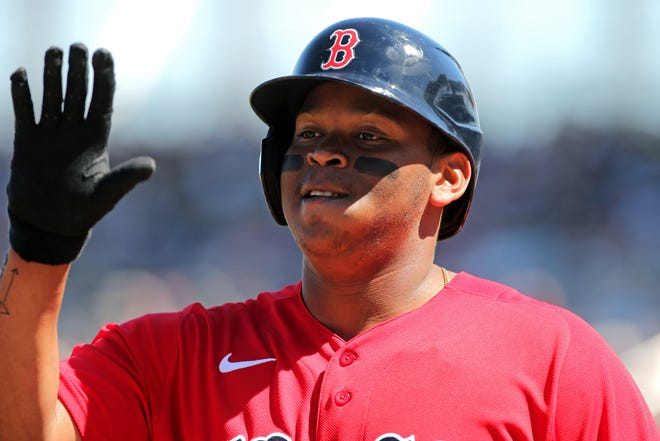 "Red Sox third baseman Rafael Devers celebrates after scoring a run against the Toronto Blue Jays in a spring training game last March at JetBlue Park. Devers says he has been ""working hard"" to improve his fielding."