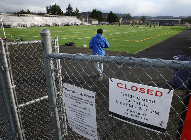 South Eugene athletes work out on the school's football field.